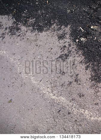 Sunlit aging scratched corrugated asphalt abstract composition