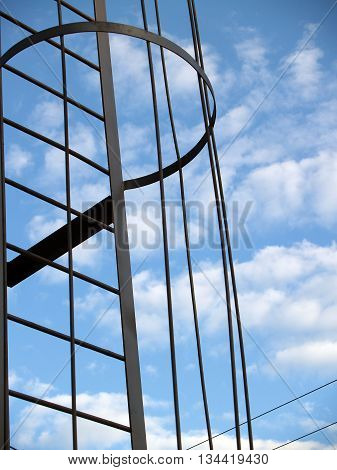 Detail of metal construction against sky and clouds