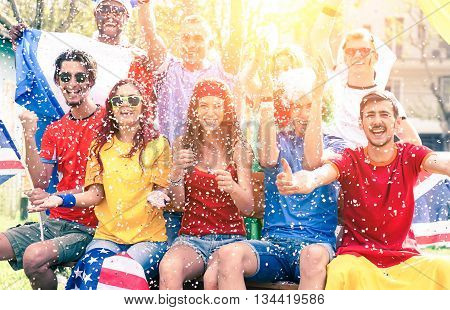 Cheering football fans exulting watching match on screen outdoors - sport supporters party and fun for international soccer game - Multiracial concept of joy and togetherness - Sun halo filter