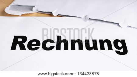 Rechnung german invoice letter with opened envelope on desk