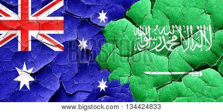 Australia flag with Saudi Arabia flag on a grunge cracked wall