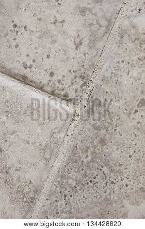 Grout that has cracked in between tiles in a home bathroom.