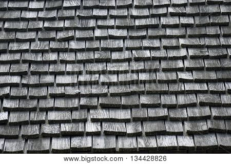 Old wood shingles roof background at historic house