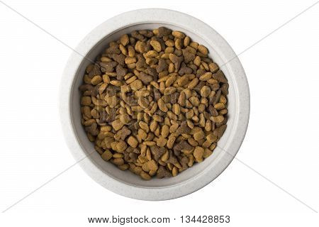 A bowl of dry cat food isolated on white.