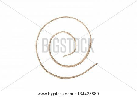 A tan colored shoelace shaped into a spiral isolated on white