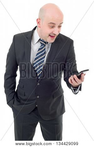 Silly businessman surprised with a cellphone. Isolated on white background