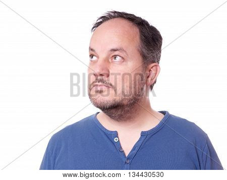 middle aged man thinking and looking up to copy space