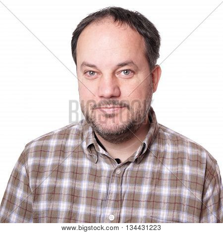 smiling middle aged man wearing checkered shirt and beard