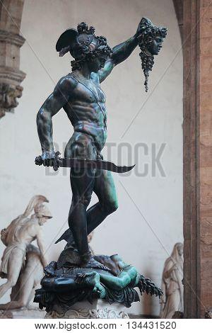 Perseus holding Medusa's head - statue from Benvenuto Cellini Piazza Della Signoria Florence Italy
