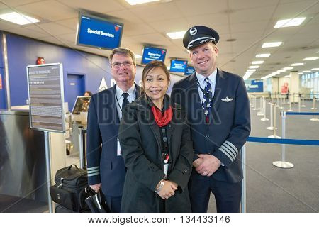 NEW YORK - MARCH 14, 2016: aircrew in JFK airport. John F. Kennedy International Airport is a major international airport located in the Queens borough of New York City, United States