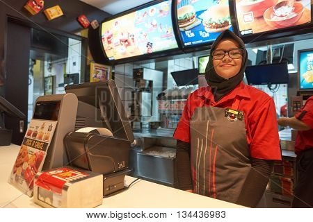 KUALA LUMPUR, MALAYSIA - MAY 09, 2016: interior of McDonald's. McDonald's is the world's largest chain of hamburger fast food restaurants.