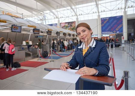 NEW YORK - APRIL 06, 2016: portrait of woman at check-in area of Lufthasa. Lufthansa, is the largest German airline and, when combined with its subsidiaries, also the largest airline in Europe.