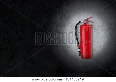 red Fire Extinguisher on concrete wall with  black vignette border
