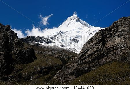 South America Beautiful Cordillera Blanca mountain. The picture presents snowcovered Piramide de Garcilaso peak Peru