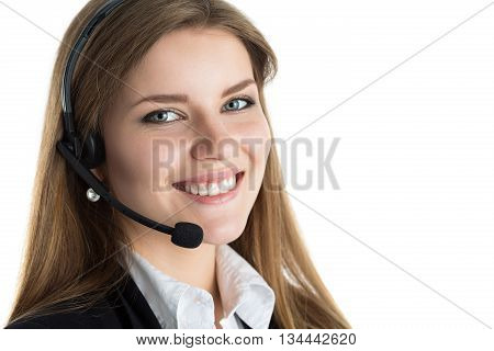 Portrait of young beautiful call center worker talking to someone. Smiling customer support operator at work. Help and support concept. Portrait over white background