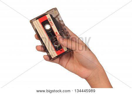 Cassette Tape. Hand Holding Cassette Tape Isolated On White Background.