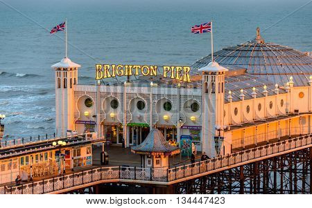 BRIGHTON, UK - CIRCA APRIL 2013: The Brighton Pier at sunset.