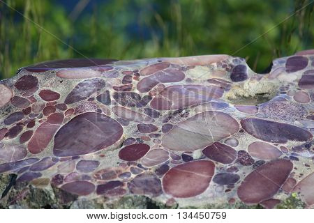 Conglomerate marble stone background texture close up