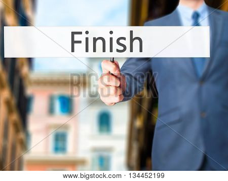Finish - Businessman Hand Holding Sign