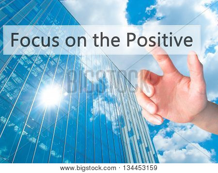 Focus On The Positive - Hand Pressing A Button On Blurred Background Concept On Visual Screen.