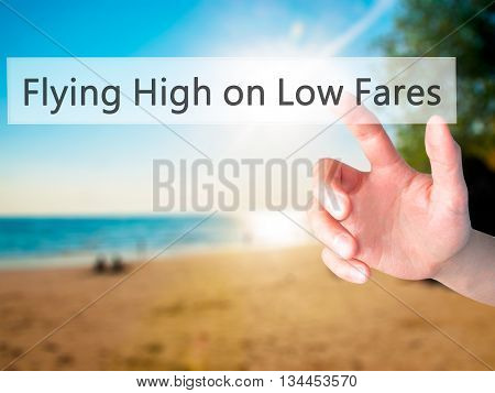 Flying High On Low Fares - Hand Pressing A Button On Blurred Background Concept On Visual Screen.