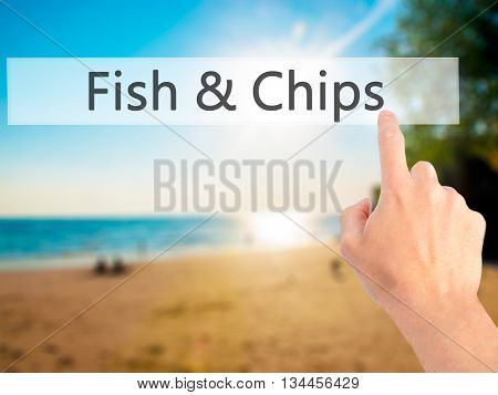 Fish  And Chips - Hand Pressing A Button On Blurred Background Concept On Visual Screen.