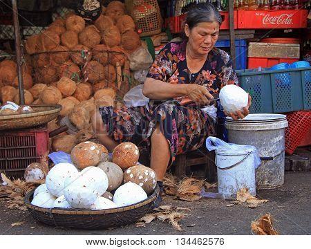 Woman Is Peeling Coconuts On Street Market In Hue, Vietnam