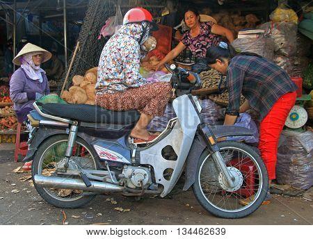 People Are Communicating On Street Market In Hue, Vietnam