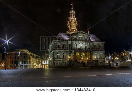 MAASTRICHT, NETHERLANDS - MAY 15, 2013: This is night view of Maastricht's Town Hall.