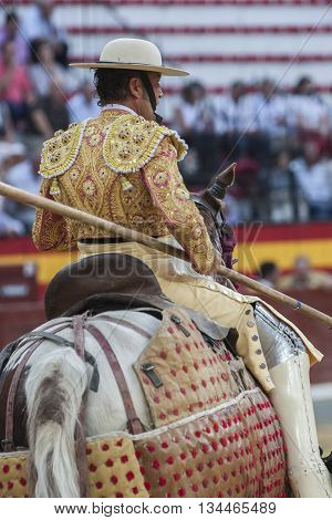 Jaen Spain - October 15 2011: Picador bullfighter lancer whose job it is to weaken bull's neck muscles in the bullring for Jaen Spain