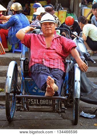 Man Is Sitting In A Cart On Street Market In Hue, Vietnam