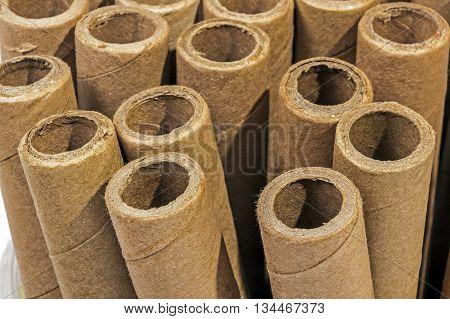Verticaly Stacked  Collection Of Cardboard Packaging Tubes
