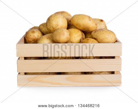 Ripe potatoes on wooden box isolated on white background
