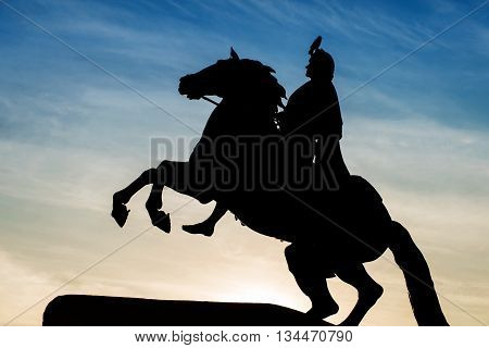 Peter the Great monument the Bronze Horseman. Silhouette against the twilight sky with crow on it. St. Petersburg Russia