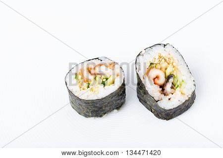 Delicious smoked unagi roll with cucumber and sesame seeds. Macro. Photo can be used as a whole background.