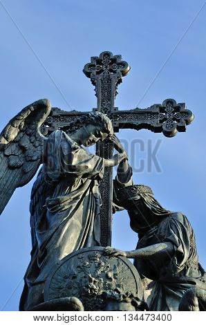 VELIKY NOVGOROD RUSSIA -JUNE 14 2016.Sculptural group- angel with the cross in his hand -Orthodox Church personification- and kneeling woman -Russia personification- at monument Millennium of Russia