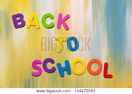 some colorful letters text back to school