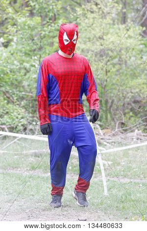 STOCKHOLM SWEDEN - MAY 14 2016: Man dressed as Spiderman participate in the obstacle race Tough Viking Event in Sweden May 14 2016