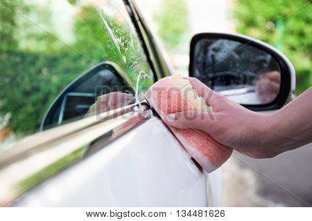Handle Car Wash Concept - Male Hand With Sponge