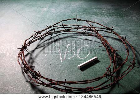 barbwire on top of blackboard
