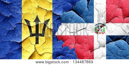 Barbados flag with Dominican Republic flag on a grunge cracked w