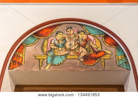 Chettinad India - October 17 2013: Chidambara Palace in Kadiapatti. Wall painting above door showing Krishna in the company of two of his wives Rukmini and Satyabhama.