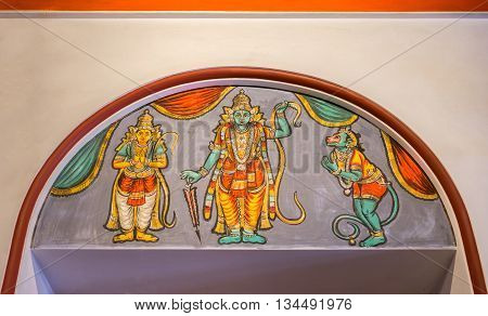 Chettinad India - October 17 2013: Chidambara Palace in Kadiapatti. Wall painting above door showing Vishnu as Rama Hamuman and Lakshmana.