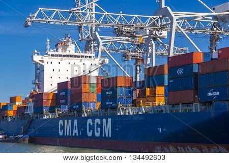 Rotterdam, Netherlands - 24 MAY 2015: Large CMA CGM container vessel unloaded in Port of Rotterdam