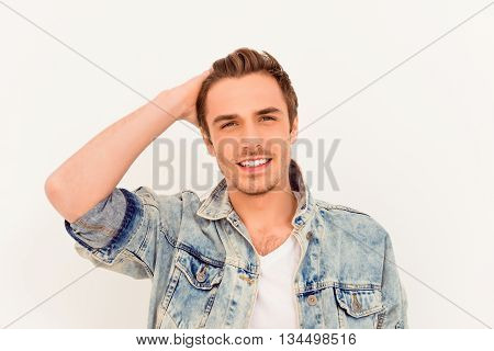 Attractive Man In Jeans Jacket Touching His Hair