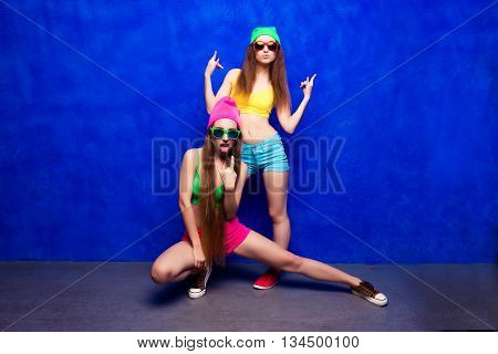 Two Sexy Hooligans Showing Fuck On Blue Background