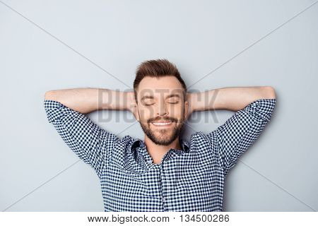 Handsome Relaxed Man With Closed Eyes Resting After Long Day