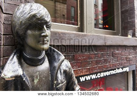 LIVERPOOL, UK. JUNE 09, 2016: Profile portrait of statue of John Lennon at entrance to The Cavern Club, on Mathew Street, where The Beatles played their first concert.