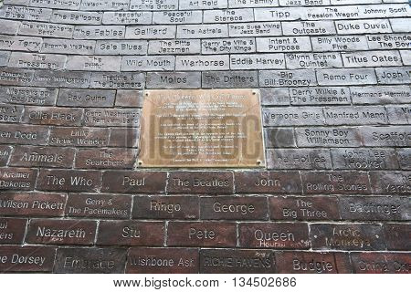 LIVERPOOL, UK. JUNE 09, 2016: Wall of fame plaque at entrance to The Cavern Club, where The Beatles played their first concert. The wall features names of famous bands that performed in the venue.