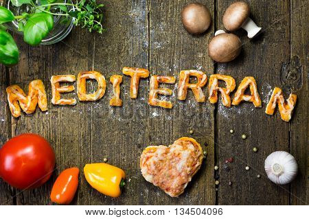 dough letters and vegetables on rustic wooden table german word mediterran which means mediterranean poster